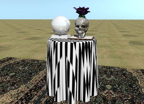 Input text: the purple blossom is in the skull. the skull has a foam texture.  The skull is on the chessboard.  The chessboard is on the checkerboard end table.  the table is on the large rug. the ground has a dirt texture.  the book is next to the chessboard.  The shiny sphere is on the book.