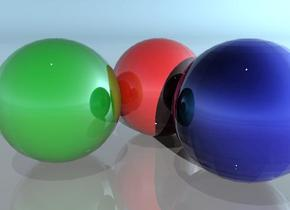 the red sphere is next to the green sphere. the blue sphere is behind the red sphere. the spheres are shiny. the ground is shiny.