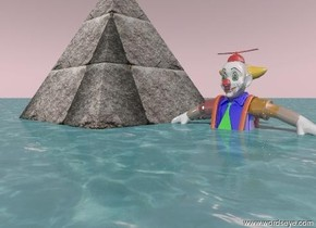 the shiny large clown is in the ground. the ground is water. The stone pyramid is 15 feet high. the sky is pink.
