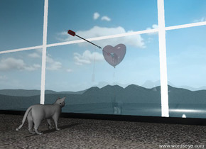 the unreflective large cat is facing the window on the tall sandy mountain range.  it is in front of the window. the window is forty feet wide. it is forty feet tall. the cat is 5 feet from the window. the glass of the window is transparent. the frame of the window is black.  the long arrow is 5 feet above the cat. it is -1.5 feet in front of the window. the arrow is facing the window.  the huge red balloon is 5 feet behind the window. the huge red balloon is 10 feet above the ground. the transparency of the balloon is 40%. the big mouse is under the balloon.  The pig is 28 inches in the huge red balloon.  the sky is partly cloudy.