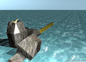 9 buoys are in the water ground. a huge rock is in the ground. a seagull is on the rock.