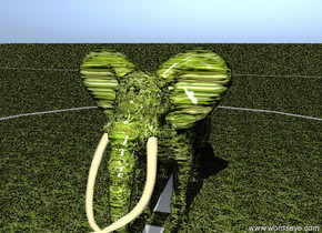 The grass elephant is on the terrain. The terrain is grassy. The ground is grass.