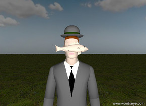 the unreflective hat is on the unreflective businessman. a small  unreflective fish is in front of the lips of the businessman. the ground is grassy. the sky is partly cloudy. the tie of the businessman is black. it is sunrise. the fish is facing right.