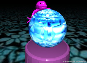 the jewel sphere is on the small grape table. the giant magenta tree frog is 6 inches behind the sphere. the tree frog is facing the sphere. the ARBRREYE of the frog is black. the ARBRLEYE of the frog is black.  the ground has a design texture. the small illuminator is 4 feet above the table. it is night.
