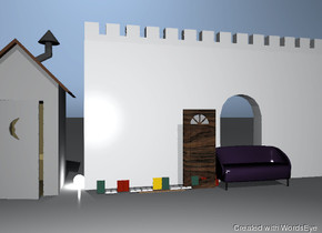 The room is big and grey. The light is grey. The dark couch is in front of the white wall. The solid door is next to the couch. The shelf is to the left of the door. The 12 books are on the shelf.