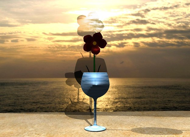 Input text: the wine glass is one foot tall. the wine glass is water. the 1 foot tall raspberry rose flower is in the wine glass. the sky is red. the ground is sand. the [sunset] wall is 1.5 feet behind the wine glass. the [sunset] wall is 5.2 feet wide. the illuminator is 2 feet in front of the wine glass.