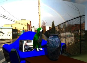 the green dog is on the blue couch. the ground has a grass texture. it is cloudy. the coffee table is in front of the couch. the vase is on the table. it has a stone texture. the wall is behind the couch. The [rainbow] image is on the wall. the cube is next to the dog. The [daniel] image is on the cube.  the illuminator is 6 feet above the vase.