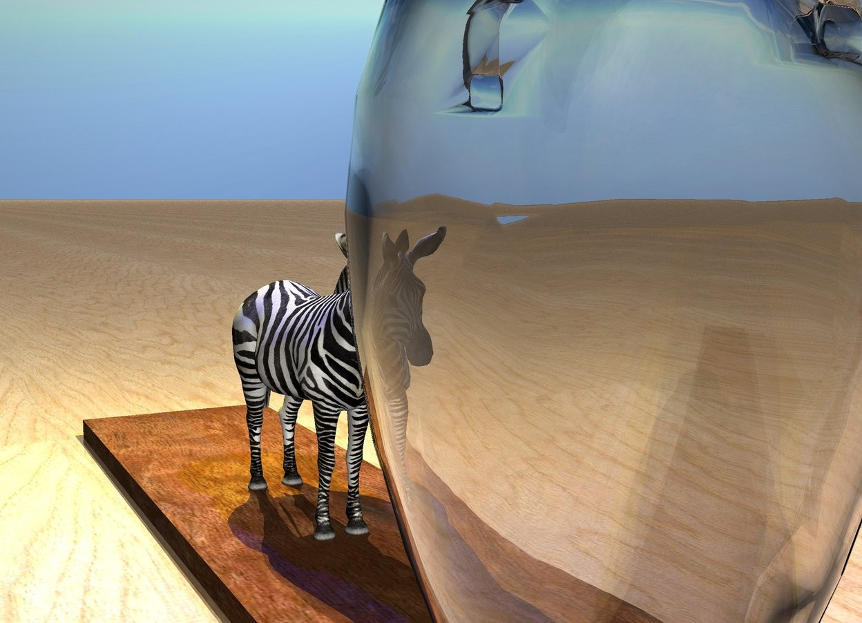 Input text: the transparent vase is on the long wood plank. a 13 inch tall zebra is 5 inches left of the vase. it is facing the vase.  the blue light and the yellow light are above the zebra.  the ground has a wood texture.
