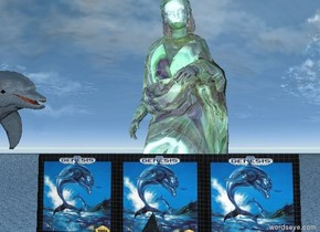 The shiny giant dolphin is facing the [image-7893] wall. the giant glass statue north of the wall. ground is water. giant shiny transparent pyramid south of the wall.