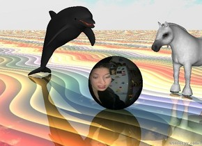 The [image-7915] sphere.  The small dolphin is 3 inches from the sphere.  The dolphin is facing the sphere.  The ground is shiny rainbow.  The small horse is 5 inches behind the sphere.