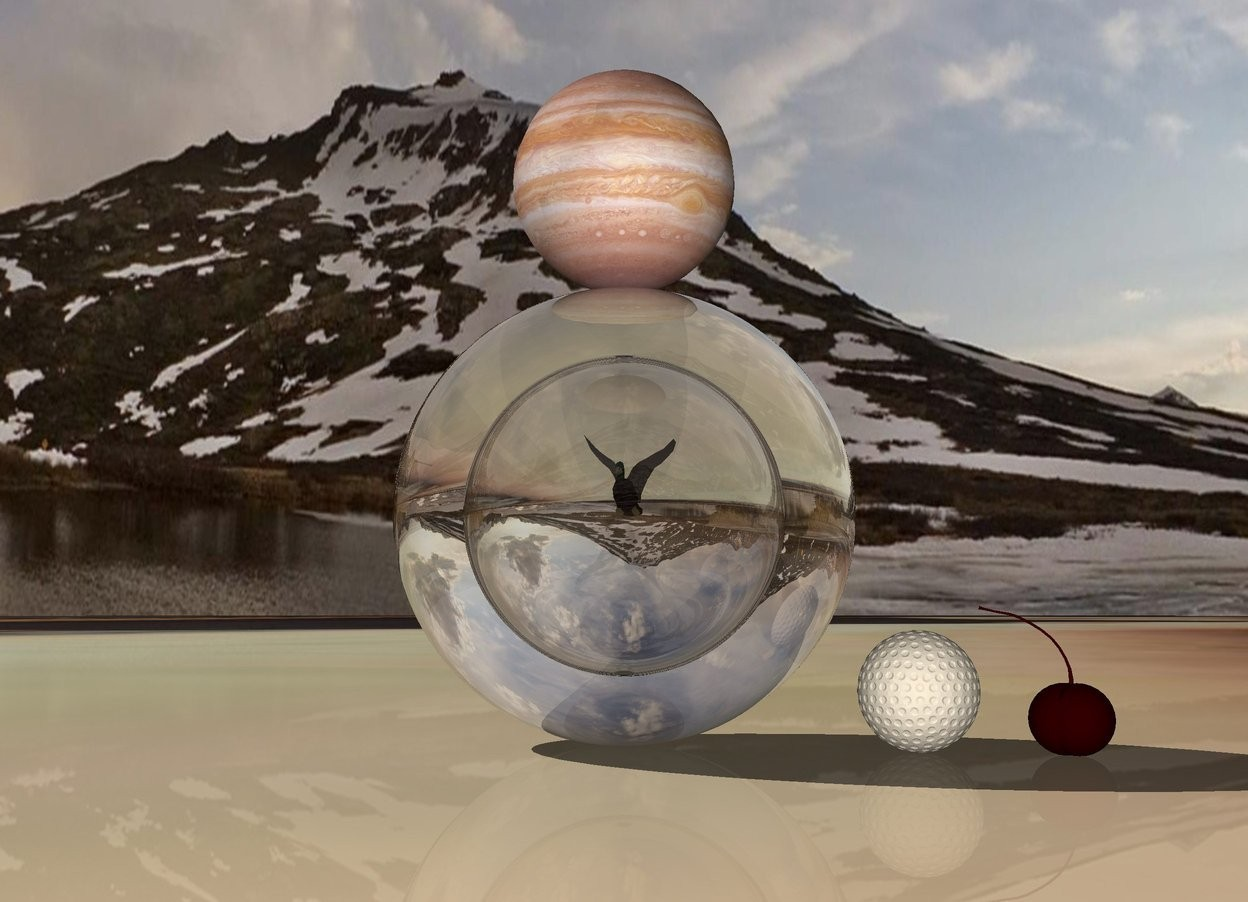 Input text: The ground is mirror. The first clear sphere is on the ground. It is 20 feet tall. The second clear sphere is 10 feet tall. It is 15 feet in the first sphere. A duck is 5 feet in the second sphere. Jupiter is above the first sphere. A 5 foot tall golf ball is to the right of the first sphere. A gigantic dark cherry is right of the golf ball.