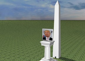 A [Trump] portrait is on a pedestal. The extremely tiny monument is 5 feet behind the portrait and on the ground. The ground is grass.