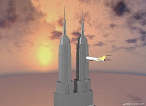 two grey empire state buildings. a large airplane. the airplane is in front of the buildings. the airplane is 500 feet above ground. the airplane faces the buildings. the airplane is 180 feet from the buildings.