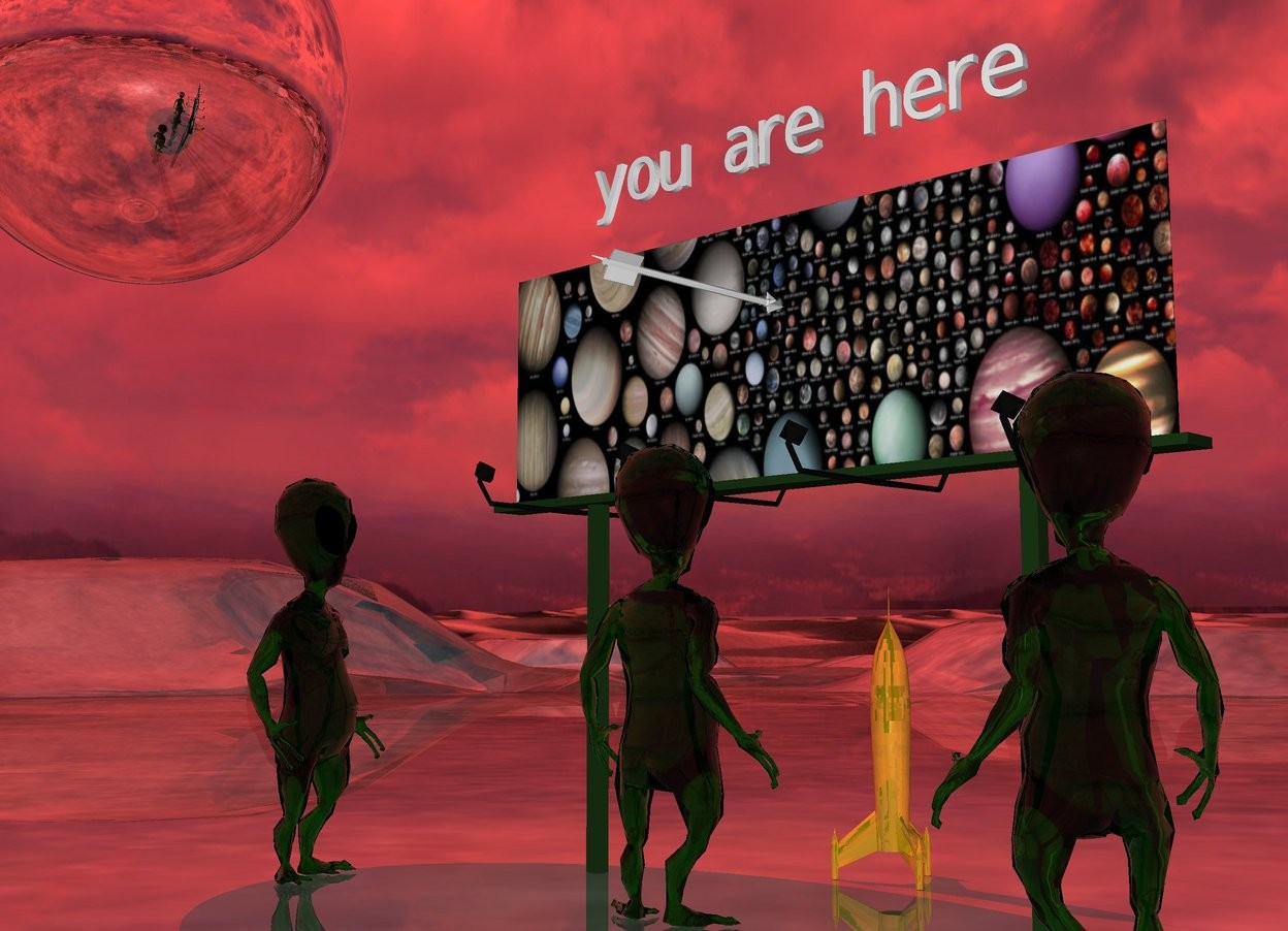 "Input text: the [planets] billboard is 10 feet wide. the 3 transparent aliens are in front of the billboard. they are three feet apart. they are facing the billboard. the sun is red. the very huge silver sphere is 7 feet to the left and 2 feet above the billboard. the small ""you are here"" is six inches above the billboard. the white arrow is in front of the  ""you are here"". it is facing backwards.  it is 1.5 feet below the ""you are here"".  the very tiny gold rocket is behind the billboard.   the ground is shiny."