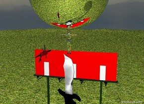 A gigantic knife is on a wide grassy mountain range. A silver man is on the knife. A Swiss billboard is behind the knife. A gigantic knife is 4 feet in front of the man and to the left. A gigantic silver sphere is 2 inches above the man's head.