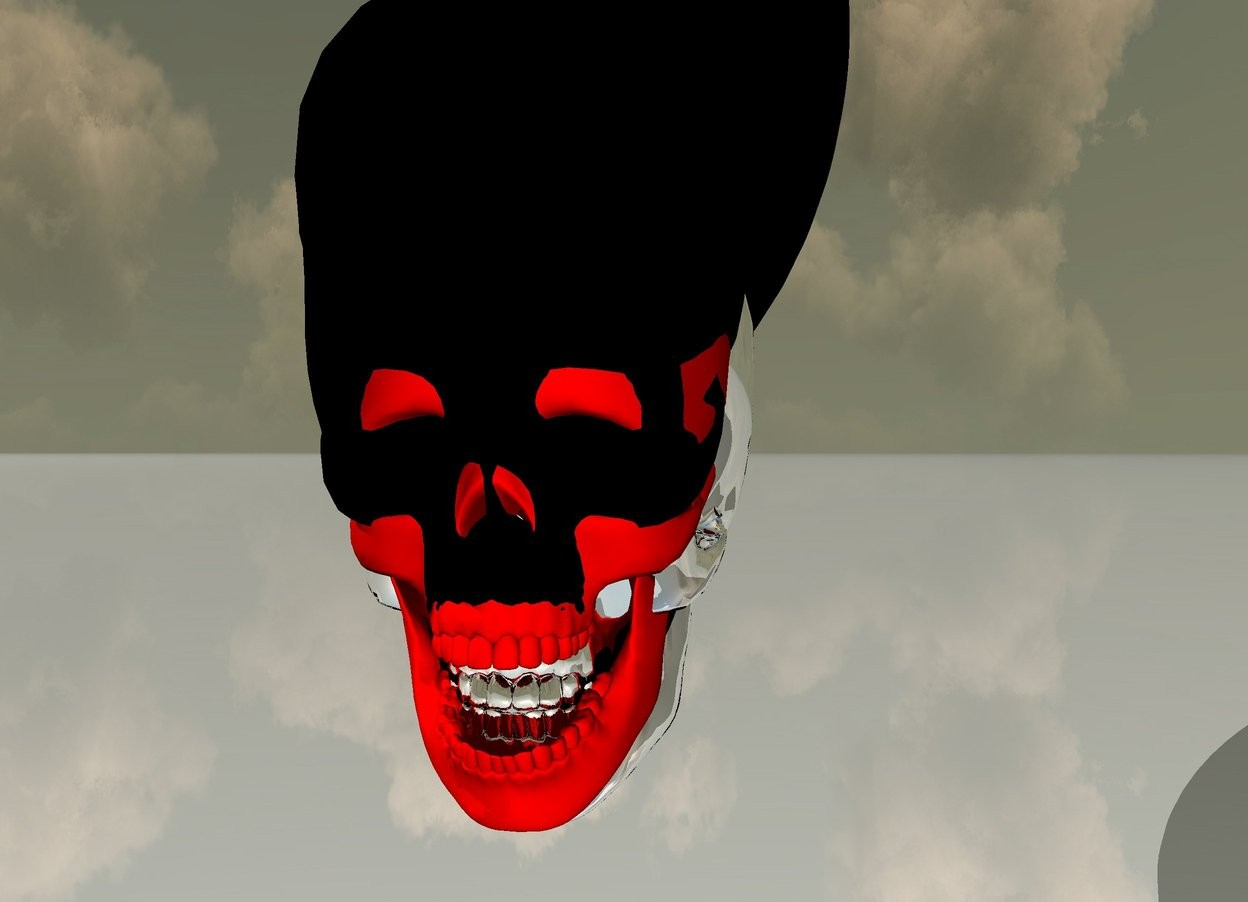 Input text: there is a 3 feet tall red skull 1 feet above the ground. there is a 3 feet tall silver skull -22 inches behind the red skull. its tooth is black. there is a 3.4 feet tall black skull -43 inches behind the silver skull. it leans south. the first black sphere is 5 feet tall 3 feet wide and 20 feet deep. the first sphere is -47 inches behind the black skull. it leans south. the ground is shiny.
