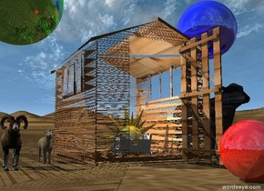 the wood structure. the tiny white cradle is 3.7 feet in the structure. the small cow is 6 inches to the right of the structure. the first very small sheep is 6 inches to the left of the structure. a second very small sheep is 6 inches to the left and in front of the first sheep. the large shiny green sphere is 1.6 feet above the sheep. the shiny red sphere is a foot in front of the structure. a large shiny blue sphere is a foot above the cow. the gold sun symbol is 8 inches in the cradle. it is 2 feet tall.  the camera light is black. the white light is 5 inches in the sun symbol.