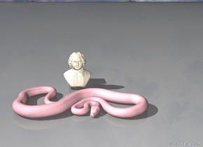 a pink python in front of the statue. there is a sunset behind them