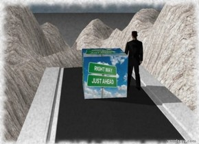 the road is in front of the stone canyon. It is 70 feet in  the air.  the huge [motivation] cube is on the road.  it is 1 foot above the road. the man is right of the cube. he is facing the canyon.the sky is cloudy.