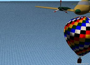 a plane.the plane is 30 feet above the ground.the ground is water.a very small hot air balloon 1 feet below the plane.