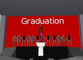 "There is a woman on a huge stage on a pedestal. 15 feet To the back of her are twelve girls on the huge stage.  Big ""Graduation"" is five feet above the girls."