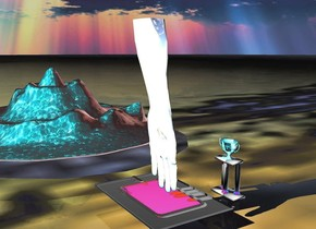 the ground is an egg. the hand is 8 feet wide. the hand is shiny white. there is a pool under the hand. there is a mountain 25 feet behind the hand. the mountain is water. 10 feet to the right of the pool is a 15 foot tall trophy. the trophy is facing west. the trophy is shiny water. 15 feet to the right of the mountain is a starfish