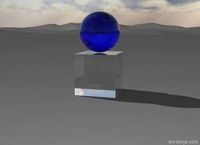 A transparent cube is standing on the ground. A transparent blue ball is standing on the cube. A transparent yellow key is on the ball.