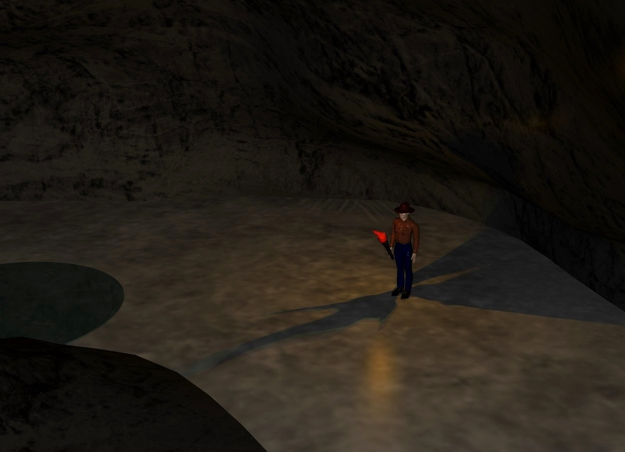 Input text: a giant gray cave. the ground is unreflective.  an unreflective man is -15 feet north of the cave. the cave is dark. a torch is -.56 feet west of the man. the torch is -.9 feet south of the man. the torch is leaning 35 degrees to the south. the torch is 2 foot off the ground. it is midnight. it is very dark. a dim red light -6 inches above the torch. a dim yellow light is -5 inches above the torch. a dim orange light is -7 inches above the torch. a small dark water pond is 9 feet southwest of the man.