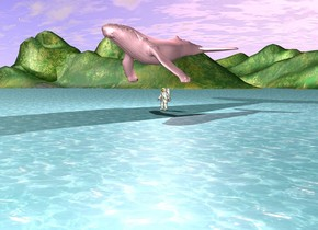 the pink whale is above the buddha. the buddha is above the sea. 2 feet above the whale there is a pink light.