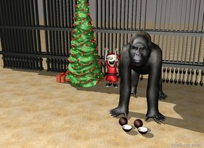 a gorilla is on a beach. an elf is on the left behind the gorilla. On the left of the elf is a christmas tree. In front of the gorilla are coconuts.behind the christmas tree is a huge fence. on the left side of the christmas tree is a present.
