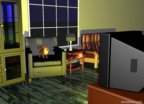 The dog is on the chair. The table is to the right of the chair. The lamp is on the table. The cup is to the left of the lamp. The huge wall is behind the chair. The coffee table is facing the chair. The coffee table is 4 feet in front of the chair. The yellow light behind the coffee table. The ground is wood. The huge wall is grey. The cabinet is to the left of the chair.The ottoman is in front of the couch. The television is on the coffee table.The couch is 3 feet to the right of the chair. The window is 1.5 feet behind the lamp. The hedge is 9 feet behind the lamp. The sky is light blue.