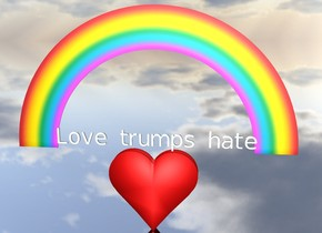 "There is a huge heart. the ground is silver. ""Love trumps hate"" is on the heart. there is a tiny rainbow in the ""Love trumps hate""."