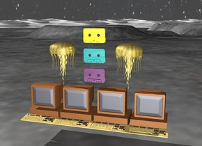 there is 4 computers 1 foot above the ground. there is a  large shiny purple cassette 3 inch above the computers. there is a large shiny teal cassette 3 inch above the purple cassette. there is a large shiny yellow cassette 3 inch above the teal cassette.  there is a big gold invertebrate  5 inches to the right and below the yellow cassette. there is a big gold jellyfish  5 inches to the left and below the yellow cassette.   the sky is dark [stars]
