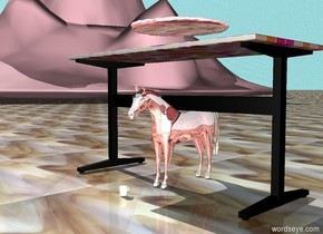 The ground is glass. The sky is water.The chrome pizza is 5 inches above the mod desk. The pink mountains are 50 feet tall. The mountains are 30 feet from the desk. The chrome horse is 2 feet tall. The horse is under the desk. The chrome mug is in front of the horse. The mug is 2 inches tall.