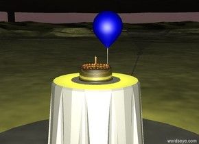 it is evening. there is a table. there is a gold cake on the table. there is a small candle on the cake. there is a balloon to the right of the table. the balloon is 2 feet above the ground. there is a yellow light above the cake