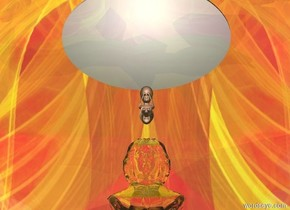 the large chrome talk bubble. the sky is [space]. the ground is fire. the camera light is blue. Transparent statue is a foot above the ground behind the talk bubble. large baby is 4 inches above the statue. large circle is 12 inches above baby. there is a light in front of baby. the circle is white.