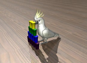 there is a cockatoo. the cockatoo is 3 feet tall. there are 5 paper cups in front of the cockatoo. the cups are purple. there are 4 paper cups on top of the cups. those cups are blue. there are 3 paper cups on top of the cups. those cups are green. there are 2 yellow paper cups on top of the cups. the ground is wood.