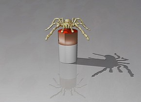 a gold spider above a cigarette