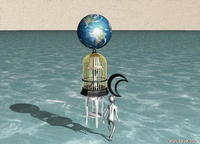 The golden cage is on the wooden table.  The small lamp is inside the cage. The ground is the blue water. The sky is the sand. The small Moon is near the cage. The small Earth is on the cage. The light is inside the lamp. The Moon is black. The small alien is near the table. The  Alien is under the Moon.