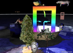 Gigantic rainbow window is in the lake. The lake fits in the bowl. The bowl is 100 feet wide. Whales are above the window. . There is the cube on the left of the bowl. The cube is 40 feet wide.  the cube is transparent.  the elephant fits in the cube. Three gigantic  butterflies are 15 feet above the elephant. The butterflies are facing the window. The big trees are  in front of the bowl. The huge hippo is on the right of the window. The hippo is 85 feet off the ground. The hippo is facing the whales. the door is 15 feet under the hippo. The door is 18 feet tall. The sphere is 12 feet tall. the sphere is 10 feet under the door. The 20 feet tall face mask is in front of the trees. it is night. the green light is on the whales. Blue light is under the hippo. Red light is on the bowl. The yellow green light is on the left of the sphere. The violet light is above the whales. The orange light is in the cube. The sphere is silver
