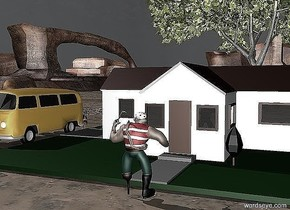 The house is on a street. The man is in front of the house. The man is facing the house. A tree is behind the house. A yellow light is behind the man. A dog is to the left of the house. It is facing the man. A car is to the left of the house. The sky is dark.