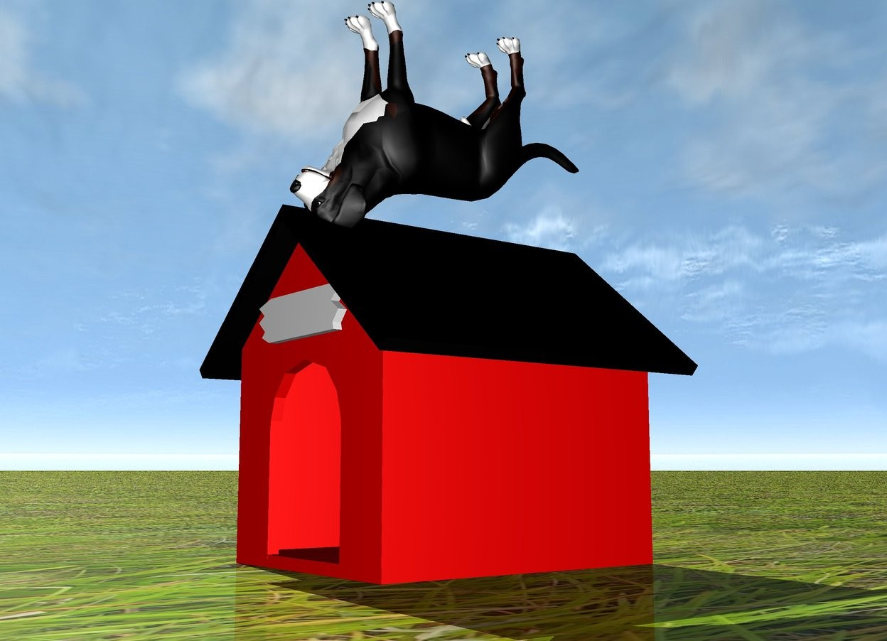 Input text: a red dog house. the ground is grass. there is a dog on top of the dog house. the dog is upside down.