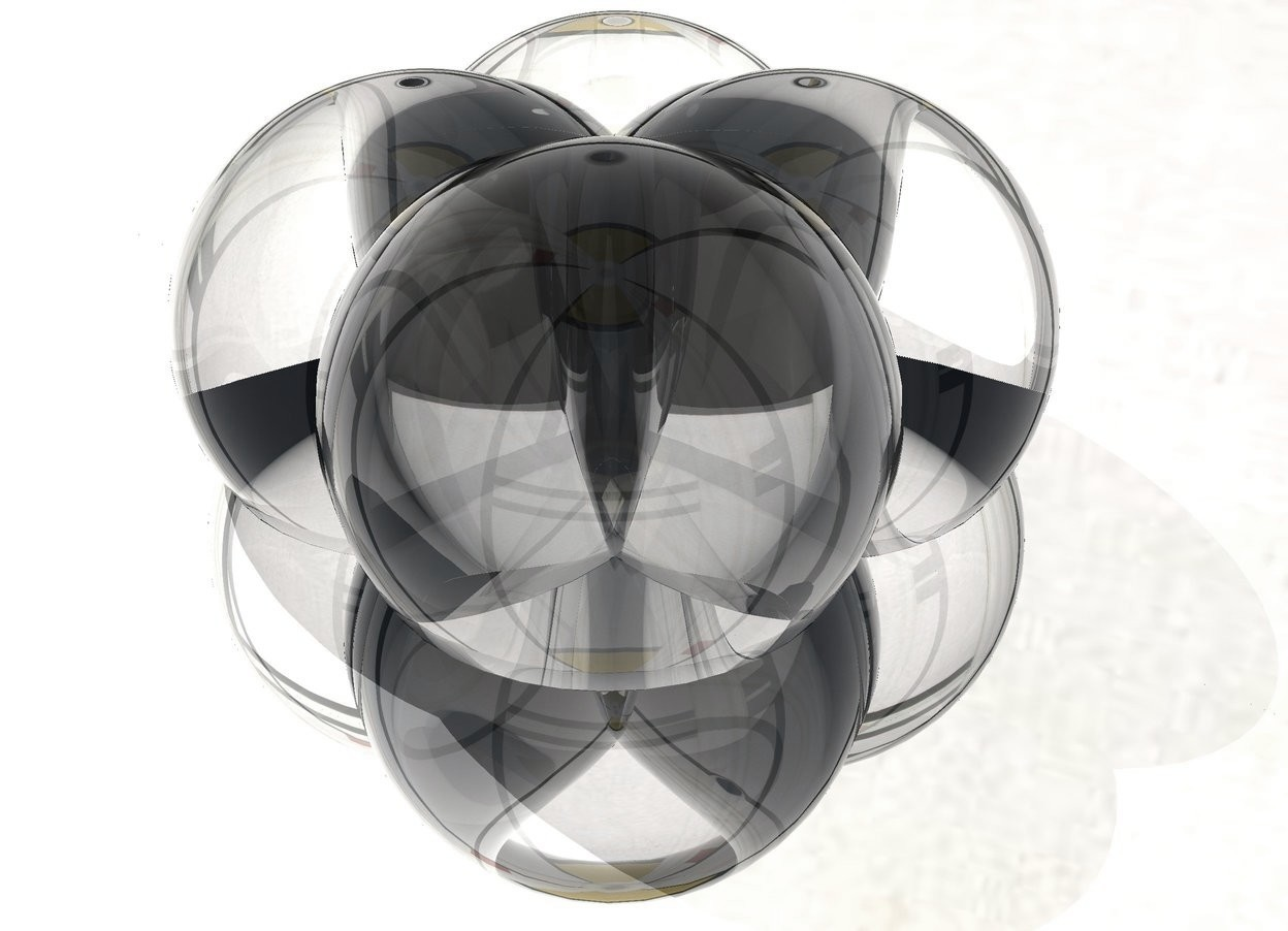 Input text: The ground is silver. A clear sphere is -3 inches above the ground. A second clear sphere is -6 inches to the right of the sphere. A third clear sphere is -6 inches behind the sphere. A fourth clear sphere is -6 inches to the left of the third sphere. The sky is mondrian.