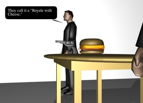 There is a large wall at the front of the large wall. the wall is facing left.  There is a table 6 feet to the right of the wall. a big burger is on the table. A man is on the left of the table. a man is on the right of the table. there is a gun in front of the burger.