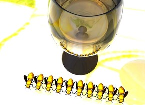 There are 10 bees on a [lemon] table. a glass is behind the bees. ground is [lemon].