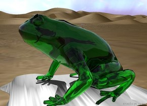 The huge clear green bullfrog is on the desert. The very huge shiny water egg is under the bullfrog. It is upside down. It is 6 inches in the ground. A second frog is 10 inches in the bullfrog. A third frog is above and in front of the second frog.