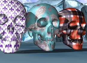 The large paisley skull to the left of the large plaid skull beside  the large Fleur de lis skull