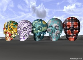 The large paisley skull to the left of the large plaid skull beside  the large Fleur de lis skull beside the large Matisse skull beside the large Van Gogh skull