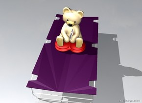A purple bed. Teddy bear on the bed
