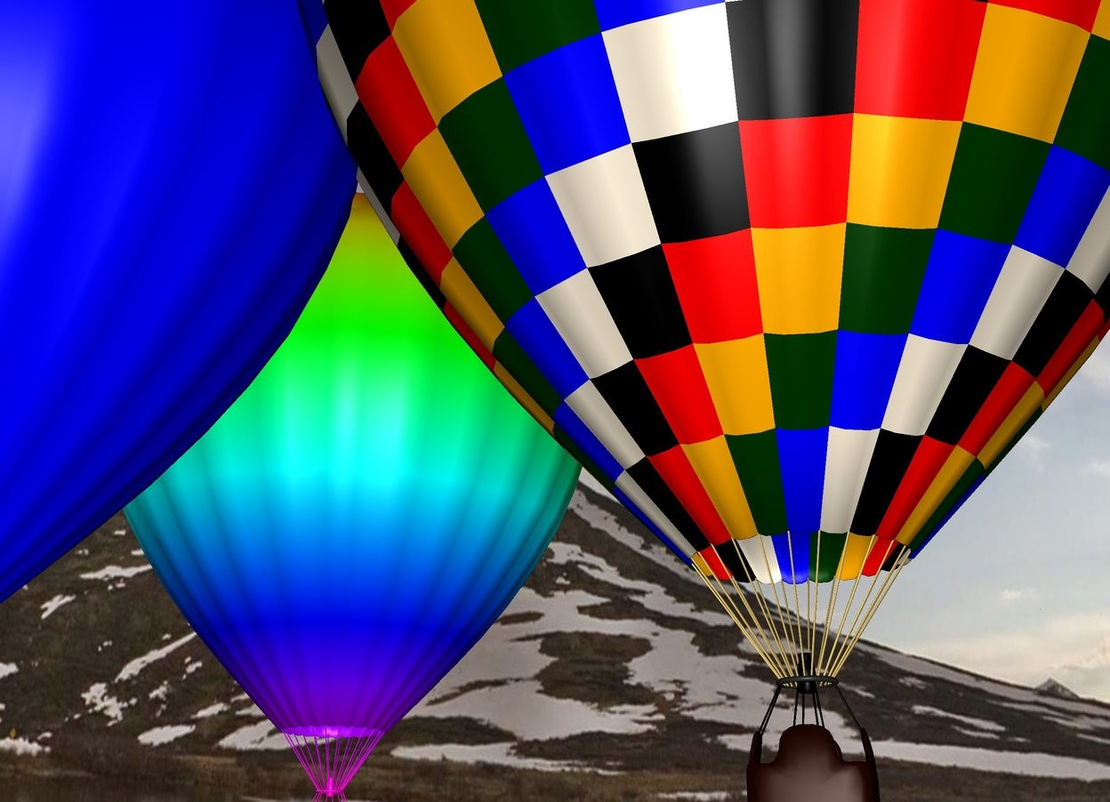 Input text: The hot air balloon is in the sky. there is a 2nd light blue hot air balloon on the left of the hot air balloon. there is a 3rd rainbow hot air balloon 5 feet behind the hot air balloon.